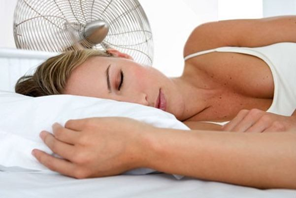 getty_rf_photo_of_woman_sleeping_with_electric_fan_thumb